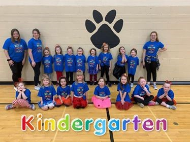 "Kindergarten students in the""This Is Me"" Elementary Dance Clinic 2020, Kindergarten is spelled out in rainbow colors."