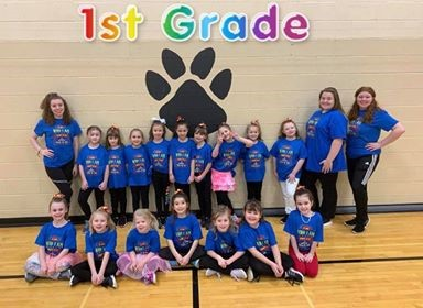 "First grade students in the ""This Is Me"" Elementary Dance Clinic 2020. First grade is spelled out in rainbow colors."