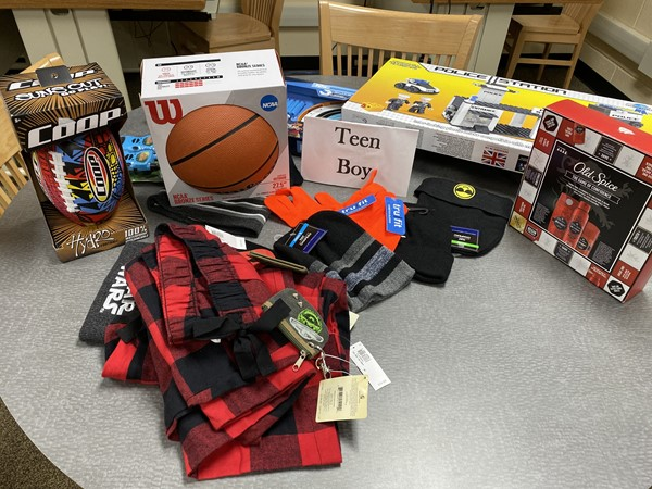 Some of the donations for teen boys, including a  basketball and football.