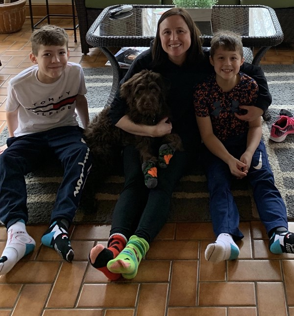 Family of three wearing unique socks.